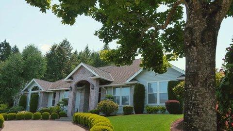 A beautiful suburban home slider shot in a very nice neighborhood on a sunny, blue sky day