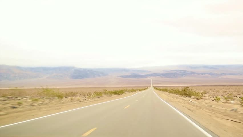 Driving through death valley down a long straight road POV  | Shutterstock HD Video #24618344