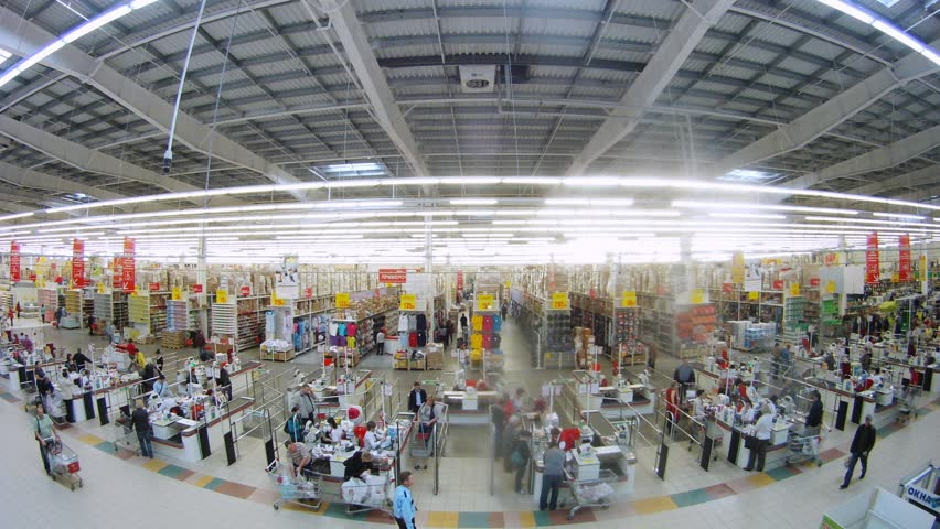SAMARA - MAY 5: (Timelapse View) People make purchases in Auchan superstore, on May 5, 2012 in Samara, Russia. French distribution network Auchan unites more than 1300 shops.