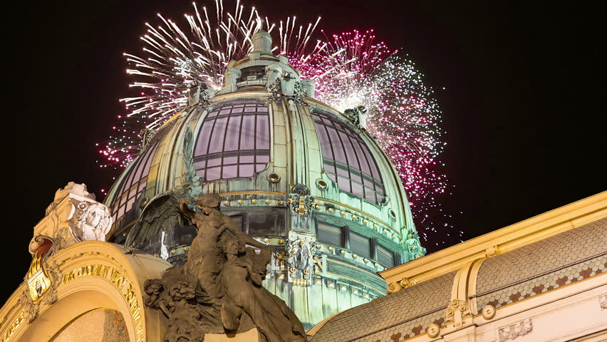 View on Municipal House (1912) in art nouveau style and holiday fireworks -- is a major landmark and concert hall in Prague, Czech Republic  #24620678