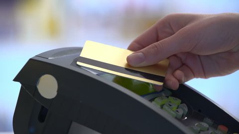 Payment in a trade with nfc system and contactless card. Close Up.