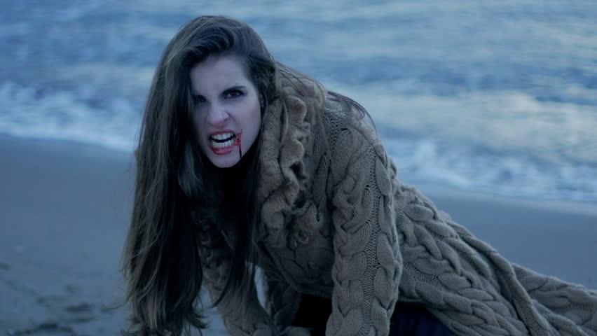 Female vampire screaming after having killed lover desperate