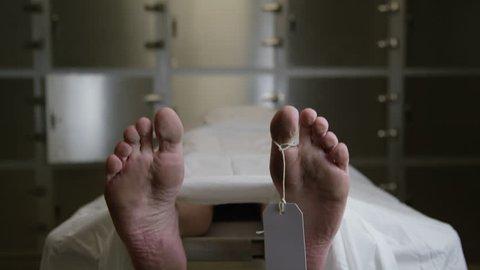 Morgue - tilt down to reveal male feet