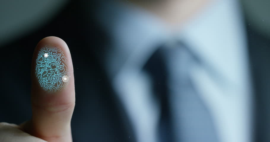 Businessman scan fingerprint biometric identity and approval. concept of the future of security and password control through fingerprints in an immersive technology future and cybernetic, business | Shutterstock HD Video #24689087