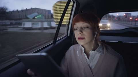 Young Businesswoman Having a Phone Call in the Car