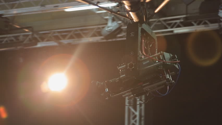 The camera on the crane moves in the pavilion during shooting | Shutterstock HD Video #24747893