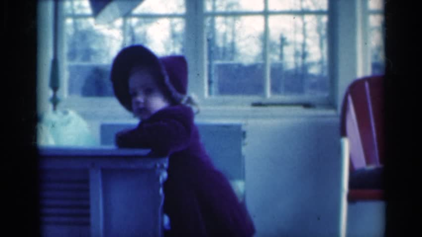 MICHIGAN 1939: kid playing and enjoying in her home #24781634