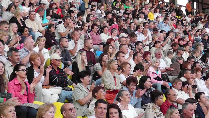 SUMY - JUNE 28: Crowd cheering on the city stadium celebrating the Day of the Constitution of Ukraine on June 28, 2012 in Sumy, Ukraine