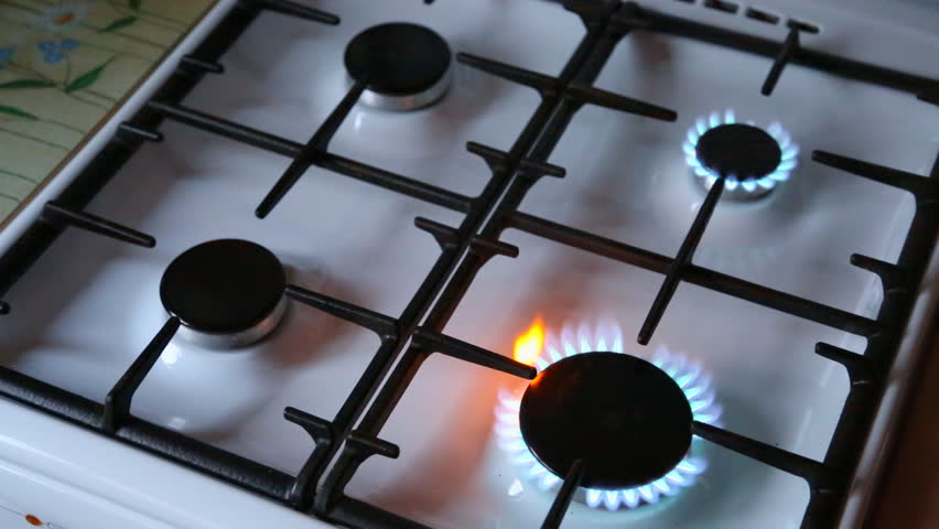 Natural Gas Inflammation In Stove Burner Close Up View Top Burners Turns On