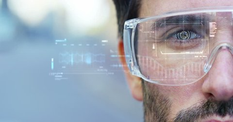 A man watches with a futuristic look with glasses augmented reality in holography. Concept: immersive technology, future, eyes, and futuristic vision.