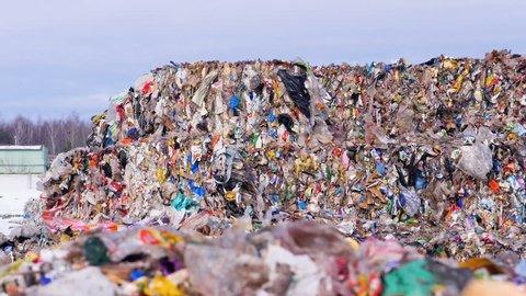Lots of plastic, waste garbage at landfillsite. Urban refuse dump.