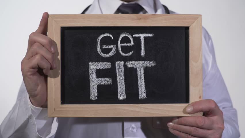 Get fit written on blackboard in doctor hands, active healthy life promotion   Shutterstock HD Video #24833504