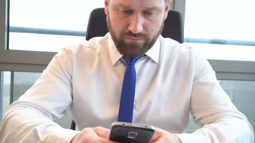 Businessman writing message sms on smartphone, close shot, sharpness on him  | Shutterstock HD Video #24843614