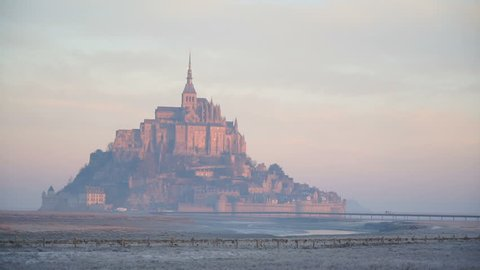 The majestic island of Mont-Saint-Michel in the dawn haze