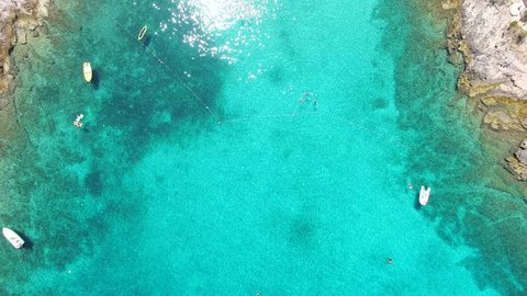 33477f968a0a Aerial view of people swimming and boats mooring at the turquoise bay on  the island of