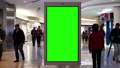 Burnaby, BC, Canada - March 07, 2017: Motion of people shopping and green sreen billboard in the middle inside Burnaby shopping mall with 4k resolution