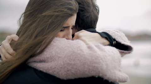 Woman hugging boyfriend feeling sad in love