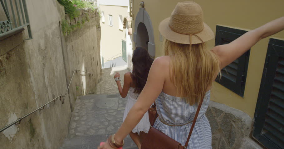 Girl friends travelling in beautiful Italy relaxing summer vacation exploring to discover carefree lifestyle #24911324