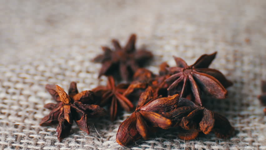 Anise and cinnamon sticks lie on sacking.Cinnamon rods and star anise on the old cloth | Shutterstock HD Video #24920594