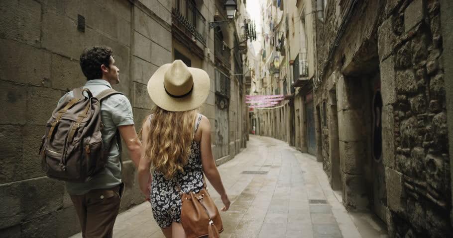 Rear view tourist woman Walking narrow streets of Barcelona Wearing cute summer dress enjoying European summer holiday travel vacation adventure | Shutterstock HD Video #24944507