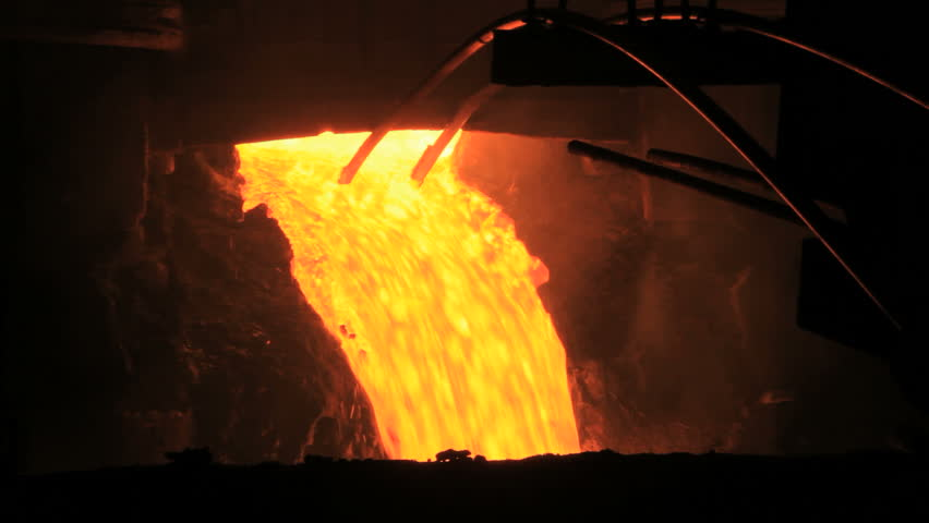 Molten metal pouring out of furnace. Liquid metal from blast furnace. Molten metal foundry. Pouring molten steel. Liquid steel pouring