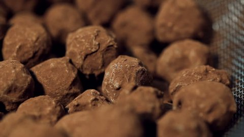 close up panoramic shot of heap of Homemade truffles in a colander sifted from the remains of cocoa.