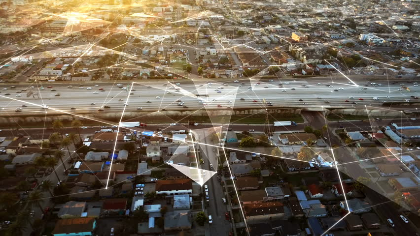 Connected freeway at sunset in Los Angeles, California. Traffic passing by. Aerial footage. United States. Futuristic. Technology.