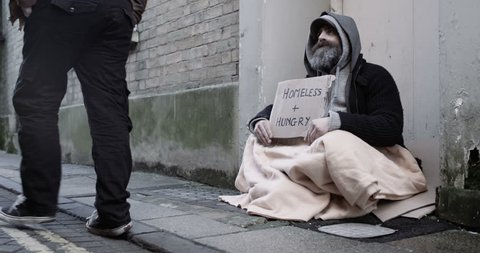 4k, A homeless man holding a sign
