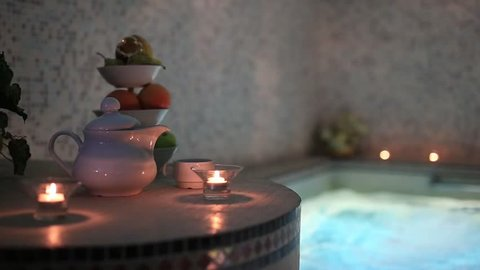 candels tea and fruits in sayna pool