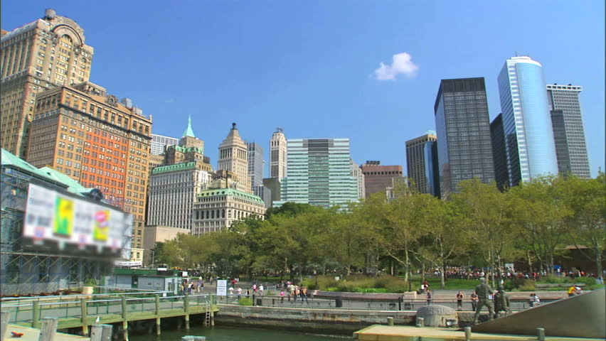 A wide shot of the skyline in Battery Park in Manhattan as seen from the Hudson river
