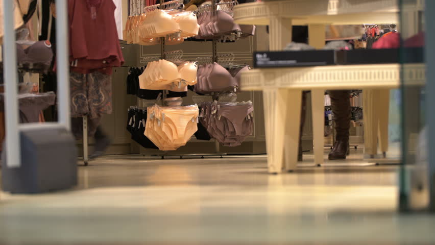 Concept of shop of intimate clothes. Panties and bras hang on hangers.