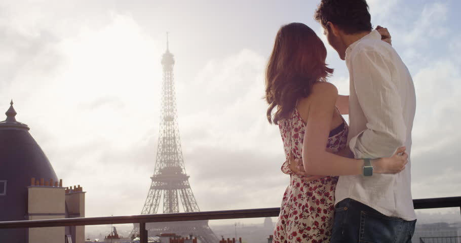 Romantic couple in Paris Eiffel Tower embrace kissing honeymoon enjoying European summer holiday travel vacation adventure | Shutterstock HD Video #25124384