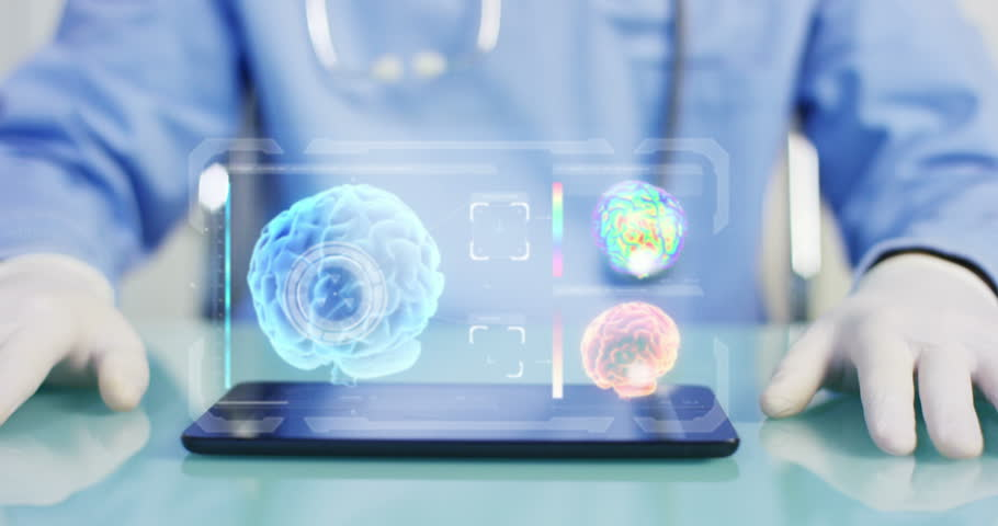 A physician, surgeon, examines a technological digital holographic plate representing the brain of patient | Shutterstock HD Video #25163627