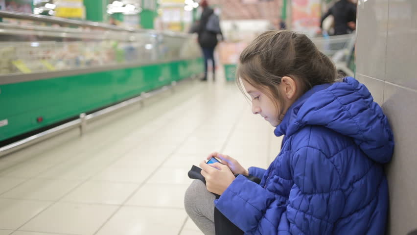 The daughter and her mother are shopping at the supermarket. Little assistant mistress | Shutterstock HD Video #25167194