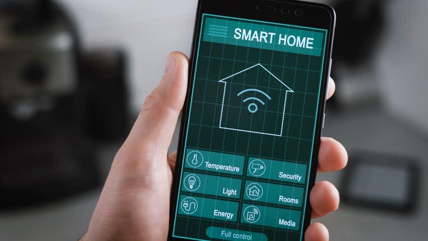 Smart House Phone smart home - man using smart home app on a smart phone. smart home