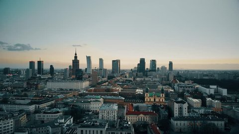 Establishing aerial shot of Warsaw downtown in the evening, Poland. 4K video