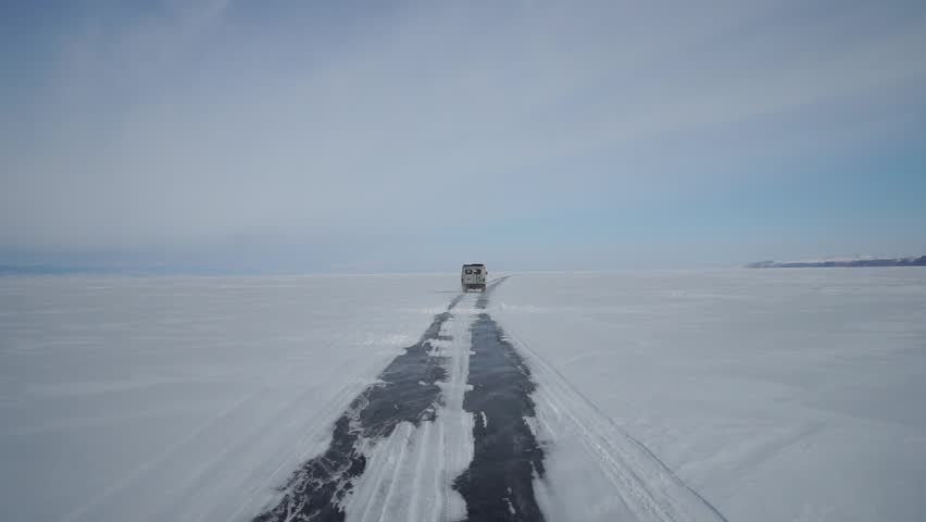 POV Car drive on the ice road over Baikal lake near Olkhon island, Irkutsk, Siberia, Russia. (Slow motion)