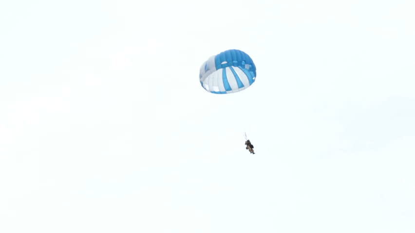 FREEDOM, SANPETE, UTAH 12 JUL 2012: Parachute smoke jumper deploys to forest fire. Wildfire burns through National Forest with smoke jumpers and fire fighting aircraft respond to the emergency.