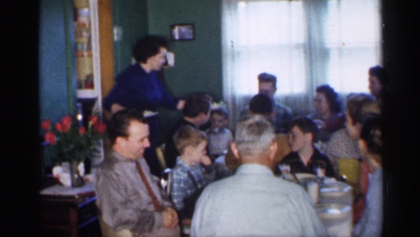 MINNESOTA 1958: big family enjoys dinner around the table while being served by the mother or waitresses | Shutterstock HD Video #25264376