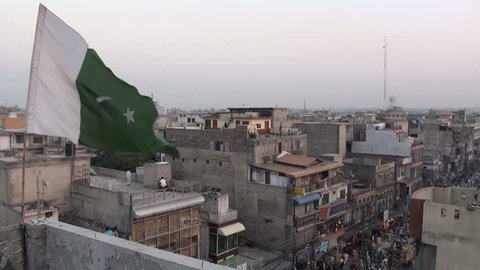 The flag of Pakistan is waving in front of the 'skyline' of Rawalpindi