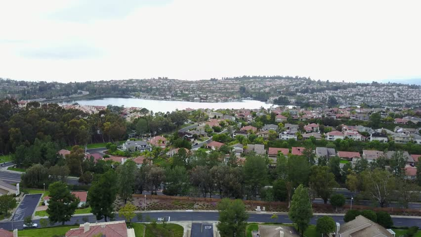Drone shot flying over Lake Mission Viejo in Orange County California.