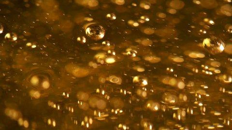 The oil bubbles slowly rise upwards