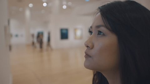 woman visiting art gallery