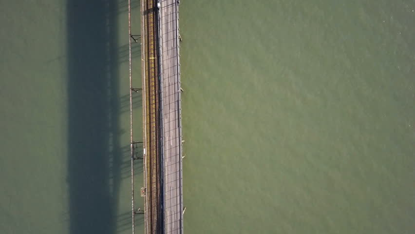 Southend Pier, Essex, England. Abstract vertical drone video footage looking down onto an empty Southend pier (Essex, UK), the longest pleasure pier in the world, showing its own train line.
