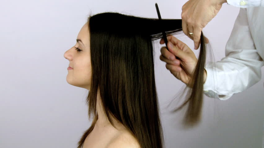 Happy Woman Attacked By Crazy Man Trying To Cut Long Hair Stock - Haircut girl model