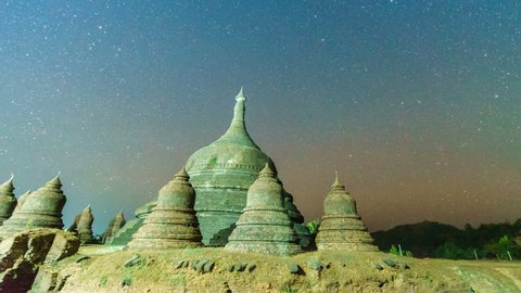 4K Day to Night timelapse zoom in motion video of moving stars over ancient pagoda in Mrauk U, Rakhine state ,Myanmar