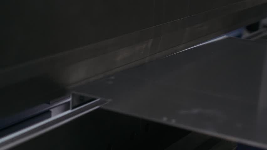 Hydraulic Press bends steel sheet. Close-up.  4k footage.     Shutterstock HD Video #25393784