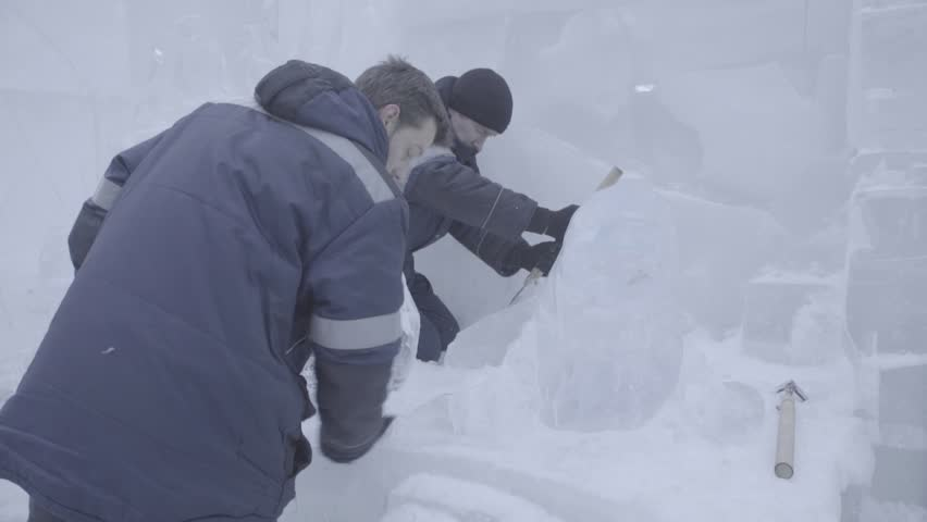 Master Scraper Performs A Movement Across The Ice To Create An Ice Sculpture. Master using Special Tool To Grind Down Form Ice Pieces. Ice Compositions Performs Notches And Grooves In The Piece Of | Shutterstock HD Video #25422944