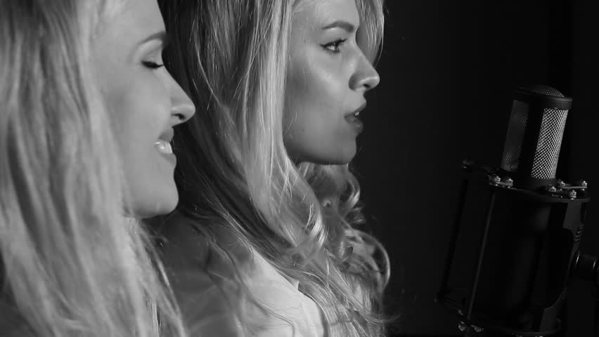 Two actresses of cinema have recorded own song at professional recording studio, the person is closeup | Shutterstock HD Video #25432004