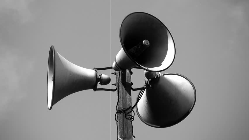 Megaphone tower w/ three speakers. Timelapse clouds with film effects (dust and scratches) applied for that black and white �newsreel� look.